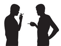Silhouettes of men smoking Stock Images
