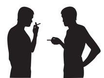 Silhouettes of men smoking Stock Images