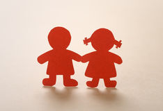 Silhouettes of men, women and heart cut out of paper Royalty Free Stock Photos