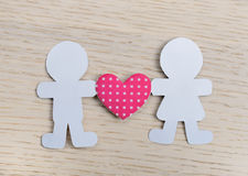 Silhouettes of men, women and heart cut out of paper Royalty Free Stock Photography