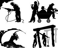 Silhouettes of of the miners Stock Photos