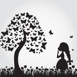Silhouettes of miracle tree from butterflies and girl. Royalty Free Stock Photo
