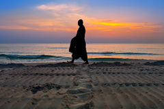 Silhouettes of monks on Hua Hin beach Royalty Free Stock Photography