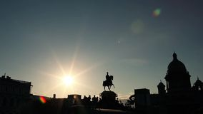 Silhouettes of monument, bunch of people underneath and extreme jumping bikers. stock footage