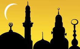 Silhouettes of mosques at sunset with moon Royalty Free Stock Photos