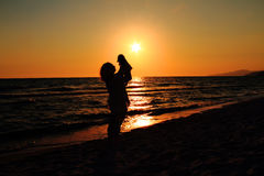 Silhouettes of mother and baby Stock Images