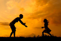 Silhouettes of mother and daughter meeting Royalty Free Stock Images