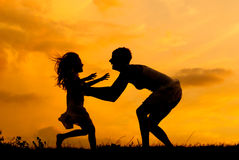 Silhouettes of mother and daughter meeting Stock Photos