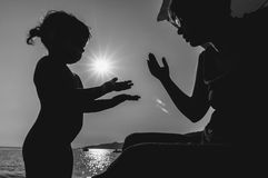 Silhouettes of a mother and her daughter Stock Photography
