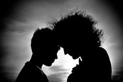 Silhouettes of mother and son Royalty Free Stock Images