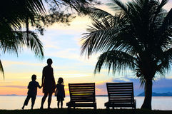 Silhouettes of mother and two kids Stock Photo