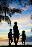 Silhouettes of mother and two kids Royalty Free Stock Image