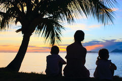 Silhouettes of mother and two kids Royalty Free Stock Images