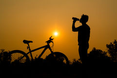 Silhouettes of mountain bike with man Royalty Free Stock Photo