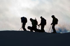 Silhouettes on the mountain range Stock Images