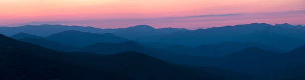 Silhouettes of the mountains at dawn Stock Images