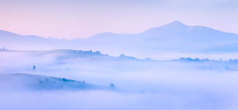 Silhouettes of the mountains in the morning mist Royalty Free Stock Images