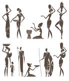 Silhouettes of native African men and women Stock Images