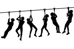 Silhouettes Of Children Playing With A Tyrolean Traverse Stock Image