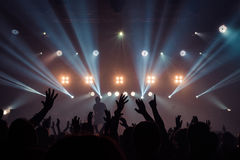 Silhouettes Of People In A Bright In The Pop Rock Concert In Front Of The Stage. Hands With Gesture Horns. That Rocks. Party In A Royalty Free Stock Image