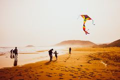 Free Silhouettes Of People Playing And Flying A Kite In Sandy Golden Beach, Karpasia, Cyprus Royalty Free Stock Images - 148470989