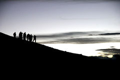 Silhouettes Of Trekkers Royalty Free Stock Photo