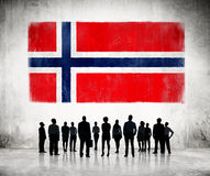 Silhouettes ofPeople Looking at the Norwegian Flag Stock Photo
