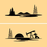 Silhouettes of oil and gas rigs in the natural environment Royalty Free Stock Photos