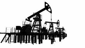 Silhouettes oil pump-jacks. Isolated stock footage