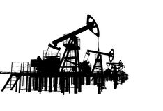 Silhouettes oil pump-jacks. Isolated Stock Photo