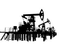 Silhouettes oil pump-jacks. Isolated Royalty Free Stock Photos