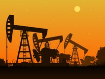 Silhouettes of oil pumps. Oil production. Pump rocking. Oil industry. Vector illustration Stock Photo