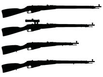 Silhouettes of old military rifles Stock Photography