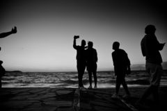 silhouettes of people taking pictures with smartphones royalty free stock photo
