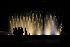 Silhouettes opposite of the fountain 5 Stock Image