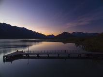 Silhouettes over Glenorchy. The evening sun passing down over the mountains creating beautiful silhouettes Stock Photos