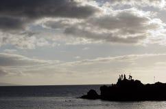 silhouettes på stranden Arkivfoto