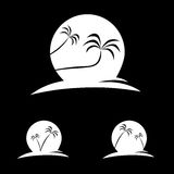 Silhouettes of palms with moon behind Royalty Free Stock Image