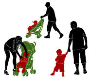 Silhouettes of parents and children. Royalty Free Stock Photography