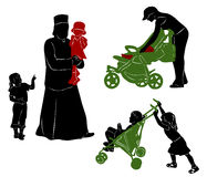 Silhouettes of parents and children. Stock Photo