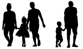 Silhouettes of parents holding kids hands Royalty Free Stock Photography