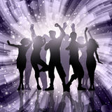 Silhouettes of party people on abstract swirl background Stock Images