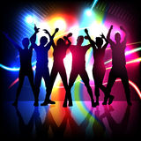 Silhouettes of party people dancing Stock Photography