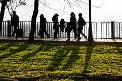 Silhouettes of passers-by of people. Stock Image