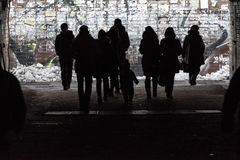 Silhouettes of pedestrians in underpass Stock Images