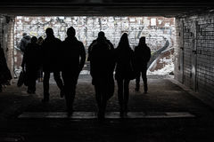 Silhouettes of pedestrians in underpass Royalty Free Stock Image