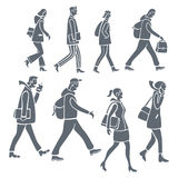 Silhouettes of people. Stylized silhouettes of people walking, on their way to work or school Stock Images