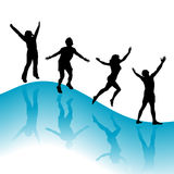 Silhouettes of people. Silhouettes of four active people on blue Stock Photo