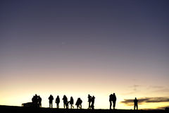 Silhouettes of people against the night sky Stock Photography
