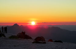 Silhouettes of people ant tents in the mountains at sunset light Royalty Free Stock Images